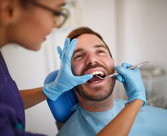 Patient receiving a preventive dentistry exam